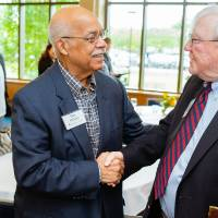 President Emeritus Don Lubbers shaking hands with a guest at the Retiree Reception.